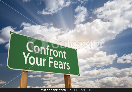 Confront Your Fears Green Road Sign stock photo, Confront Your Fears Green Road Sign with Dramatic Clouds and Sky. by Andy Dean