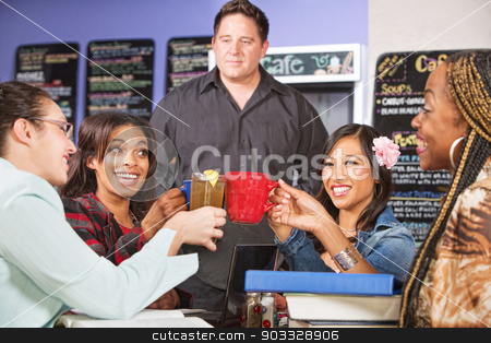 Students Holding Drinks stock photo, Male coffee house barista with students celebrating by Scott Griessel