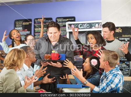 Customers Yelling at Waiter stock photo, Diverse customers yelling at frustrated waiter in cafe by Scott Griessel