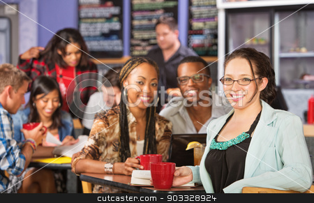 Smiling Young Female Student stock photo, Smiling young woman with group of students in bistro by Scott Griessel
