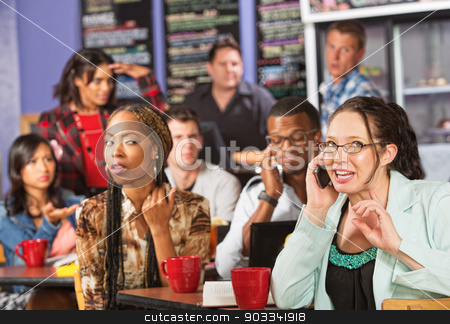 Rude Woman on Phone in Cafe stock photo, Annoyed students watching loud woman on cell phone by Scott Griessel