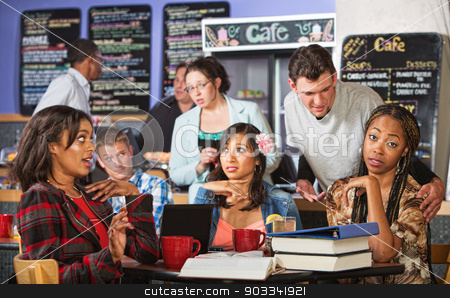 Man Annoying Students in Cafe stock photo, Annoyed beautiful students and suave man in cafe by Scott Griessel