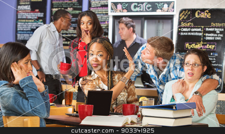 Infatuated Male with Students stock photo, Infatuated male trying to kiss group of women by Scott Griessel