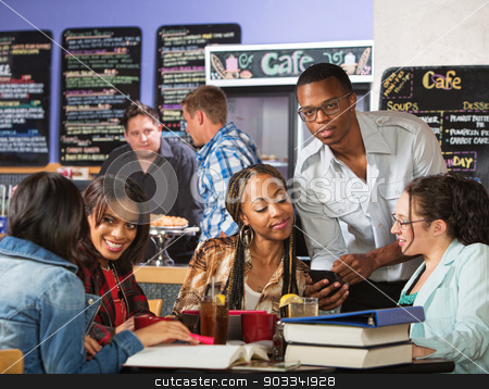 Cute Student Showing Phone stock photo, Cute student with eyeglasses showing women his phone by Scott Griessel