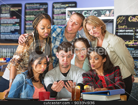 Diverse Students Making Camera Faces stock photo, Diverse students sticking out tongue for camera phone by Scott Griessel
