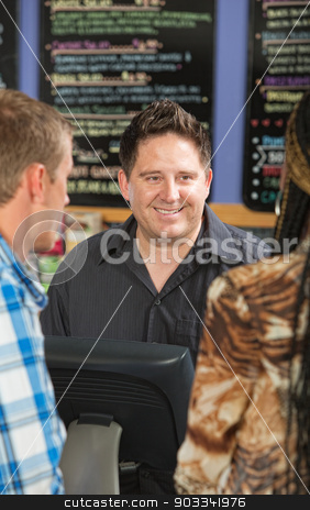 Male Cafe Cashier stock photo, Smiling handsome coffee house cashier with customers  by Scott Griessel