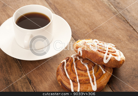 Coffee with Danish pastries stock photo, Freshly brewed full roast cup of filter or espresso coffee served with flaky fruity Danish pastries drizzled with icing sugar for a tasty coffee break by Stephen Gibson