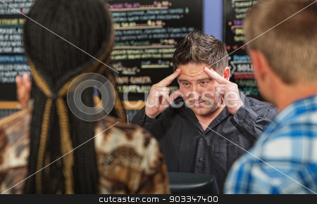 Stressed Out Entrepreneur stock photo, Stressed out restaurant owner with long line of customers by Scott Griessel