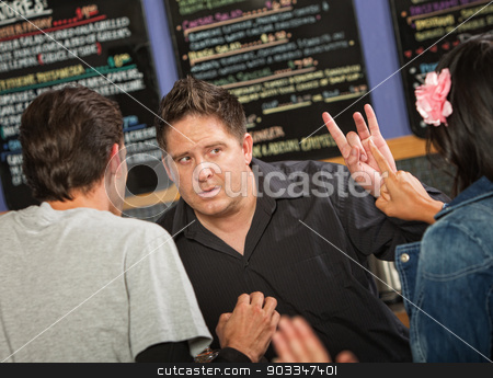 Cafe Owner with Rude Customer stock photo, Cafe owner talking with rude customers in line by Scott Griessel