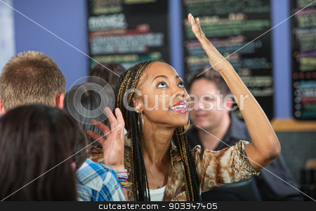 Annoyed Woman in Line stock photo, Annoyed Latina customer with hands on head at cafe by Scott Griessel