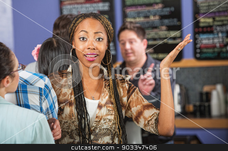 Frustrated Customer in Line stock photo, Frustrated female customer with hands up in line by Scott Griessel