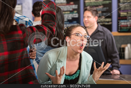 Emotional Customer in Cafe stock photo, Emotional white female customer in line at coffee house by Scott Griessel