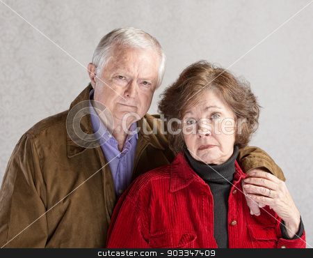 Serious Mature Couple stock photo, Serious European man and woman holding hands by Scott Griessel