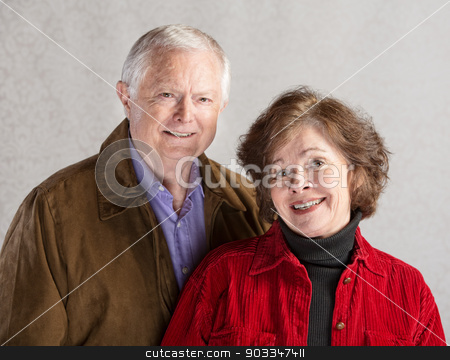Happy Couple stock photo, Adorable white senior citizen couple on gray background by Scott Griessel