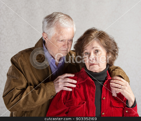 Concerned Husband stock photo, Concerned mature husband comforting depressed senior wife by Scott Griessel