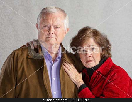 Serious Older Couple stock photo, Serious Cauccasian older couple over gray background by Scott Griessel
