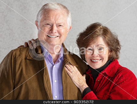 Loving Senior Couple stock photo, Happy smiling white senior couple standing together by Scott Griessel