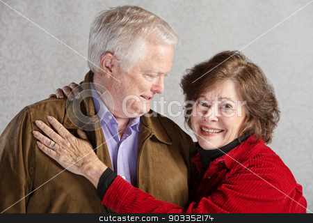 Happy Husband and Wife stock photo, Grinning senior husband looking at his smiling wife by Scott Griessel