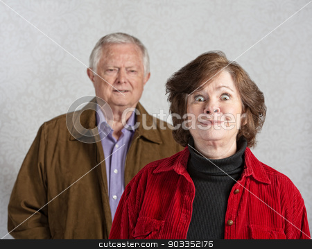 Woman Teasing Man stock photo, Funny senior European woman teasing confused man by Scott Griessel