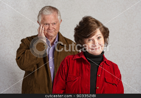 Blushing Man with Woman stock photo, Senior male blushing while happy woman is smiling by Scott Griessel