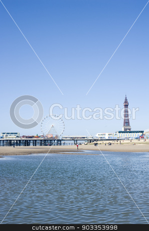 Blackpool Tower and piers, Blackpool, England stock photo, View across the sea of the waterfront and beach with the Blackpool Tower and piers, Blackpool, England by Stephen Gibson