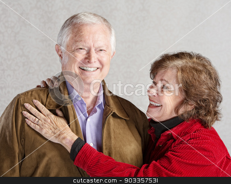 Smiling Woman and Husband stock photo, Smiling senior woman holding her happy husband by Scott Griessel