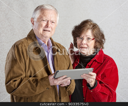Confused Adults with Tablet stock photo, Two mature adults confused with tablet computer by Scott Griessel