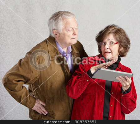 Nosey Man and Lady with Tablet stock photo, Suspicious man looking over shoulder of woman with tablet by Scott Griessel