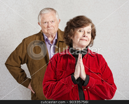 Innocent Lady with Grumpy Man stock photo, Grumpy old man behind beautiful innocent lady by Scott Griessel