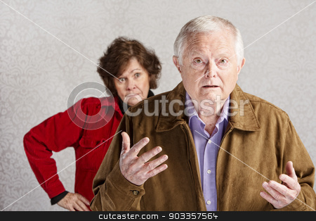 Bickering Couple stock photo, Frustrated older man with hands up and annoyed woman by Scott Griessel