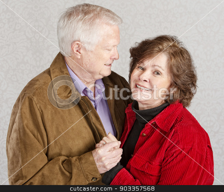 Man Admiring His Wife stock photo, Husband looking at his smiling wife and holding hands by Scott Griessel