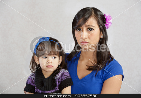 Disappointed Mother with Child stock photo, Disappointed Asian mother holding serious female toddler by Scott Griessel