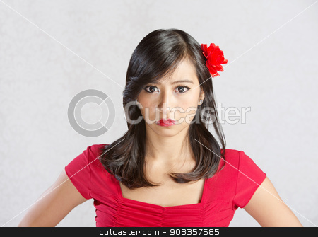 Serious Young Female stock photo, Serious beautiful Native American female with flower in hair by Scott Griessel