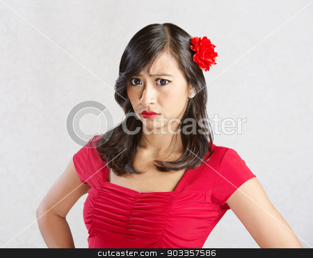 Annoyed Female in Red stock photo, Annoyed beautiful young female with red flfower in hair by Scott Griessel