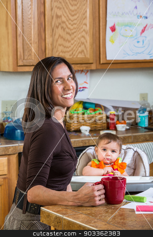 Mother Smiles With Baby stock photo, Smiling mother poses with her baby by Scott Griessel
