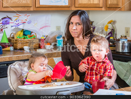 Stressed Out Mother stock photo, Stressed out mother in kitchen with her babies by Scott Griessel