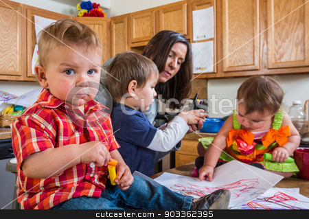 Baby Looks at You. stock photo, Baby in kitchen with guilty face looks at camera by Scott Griessel