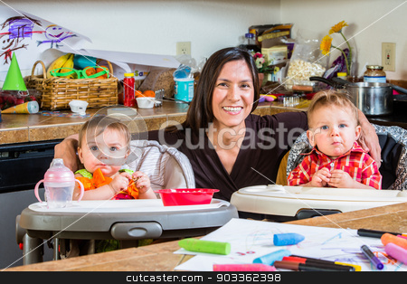 Mother Smiles With Babies stock photo, Smiling mother poses with her babies by Scott Griessel