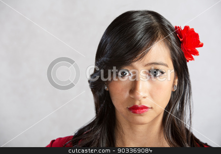 Calm Woman stock photo, Calm beautiful Asian female with red flower by Scott Griessel