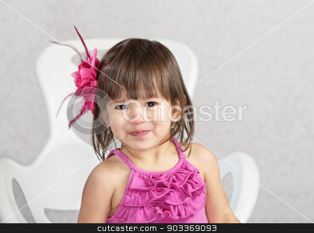 Cute Girl in Chair stock photo, Cute mixed Asian child sitting in chair by Scott Griessel