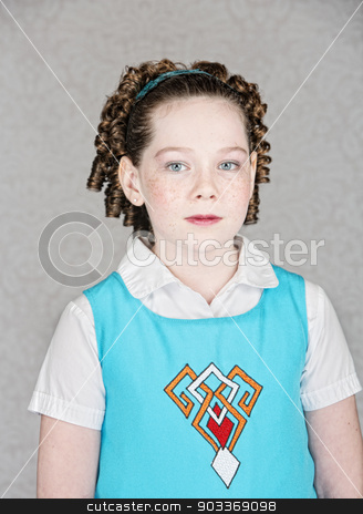 Serious Irish Child in Blue stock photo, Female Irish child with freckles and curls by Scott Griessel