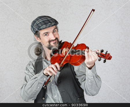 Smiling Irish Fiddler Performing stock photo, Single Irish fiddler in beard playing instrument by Scott Griessel