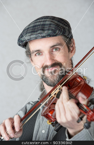Close Up of Irish Fiddler stock photo, Close up of cute Irish fiddler with instrument by Scott Griessel