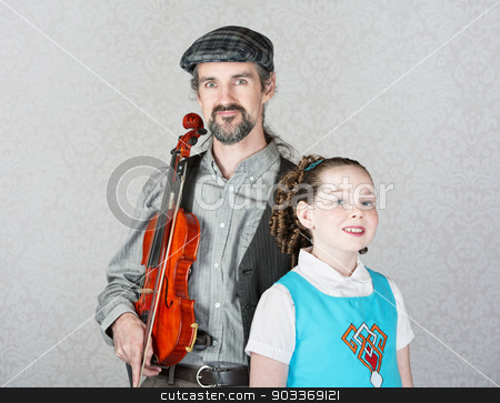 Celtic Folk Performer with Child stock photo, Irish folk music parent holding violin with cute child  by Scott Griessel