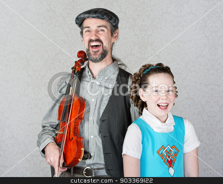Laughing Celtic Fiddler and Girl stock photo, Laughing Irish folk fiddle player with happy child by Scott Griessel
