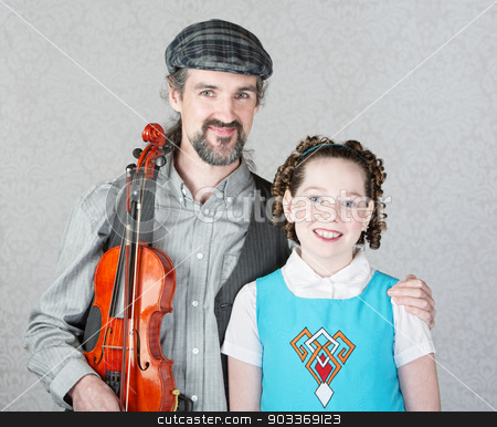 Celtic Folk Musician with Daughter stock photo, Irish folk fiddler in beard holding violin with child by Scott Griessel