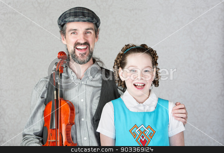 Happy Irish Musician with Child and Fiddle stock photo, Happy irish folk musician and child laughing together by Scott Griessel