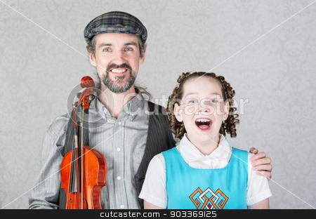 Irish Folk Singers stock photo, Singing girl with curls with Irish folk performer by Scott Griessel