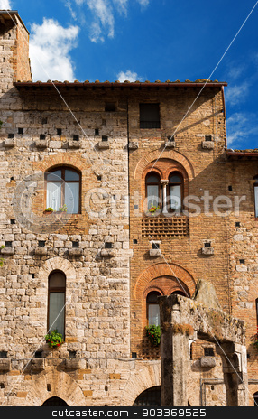 San Gimignano - Siena Tuscany Italy stock photo, Old Buildings on the Cisterna square on blue sky, San Gimignano medieval town (UNESCO heritage), Siena, Tuscany, Italy by catalby