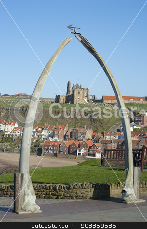 Whalebone arch in Whitby, North Yorkshire stock photo, Whalebone arch in Whitby, North Yorkshire, constructed from two jaw bones to commemorate whaling in the region framing the ruins of Whitby Abbey on Tate Hill by Stephen Gibson